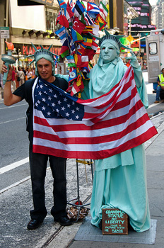 Posing With Statue of Liberty